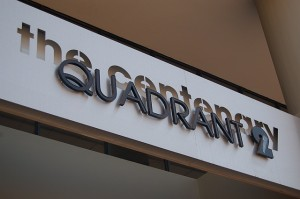 Laser cut out brushed aluminium with fabricated perspex lettering